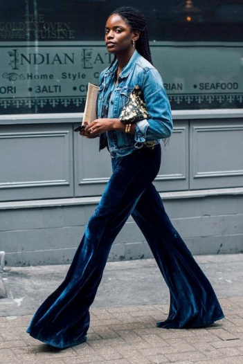 Le-Fashion-Blog-Winter-Street-Style-Trends-Gold-Hoop-Earrings-Jean-Jacket-Printed-Clutch-Dark-Blue-Flared-Velvet-Pants-Via-British-Vogue